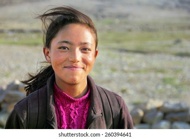 LEH, INDIA - JUNE 25: Unidentified Tibetan girl poses for a photo on June 25, 2014 in Leh, Ladakh, Himalayas, Jammu & Kashmir, Northern India. There are many refugees from Tibet living here.