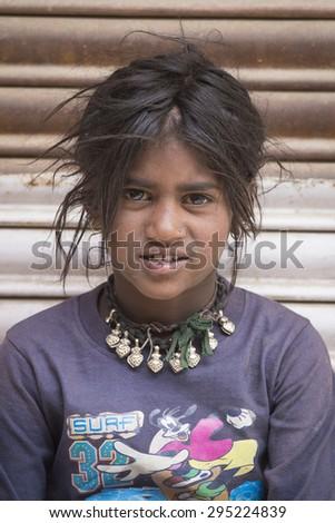 Poor indian beggar family on street in leh ladakh india