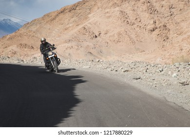 Leh. INDIA. OCTOBER  27, 2018 :   Motorbike tourist Royal Enfield most popular ride on a Leh