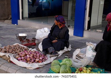 LEH, INDIA - SEP 11, 2017 - Ladakhi woman selling vegetables in the central market of Leh, Ladakh, India