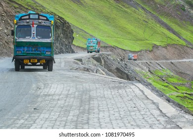 LEH, INDIA - SEPTEMBER 1, 2014 : Trucks carrying goods are passing through Zojila Pass, a high mountain pass between Srinagar and Leh at 11575 ft, 9 Km stretch. Highest Indian National Highway.