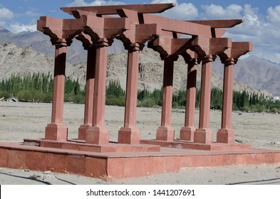 Leh, Jammu and Kashmir - August 2014: The red pillar like structure on the bank of river Indus popularly known as Sindhu is called Sindhu Ghat.