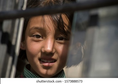 Leh, Jammu and Kashmir, India - July 26, 2011: Sweet girl from Leh in the bus coming back home after class, smiles :)