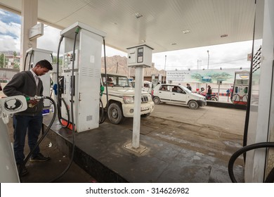 LEH LADAKH , INDIA - AUGUST 11 : The petrol station and vehicles in summer time in Leh Ladakh,India on August 11, 2015.