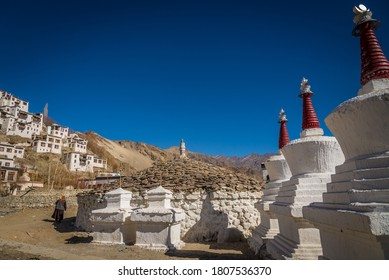 Leh, Ladakh / India - January 22 2018: Old woman praying and chanting in at the foothill of monastery.