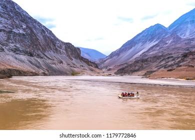 LEH, LADAKH, INDIA – JUNE 27, 2018: Tourists rafting on the Zanskar river in Leh, Ladakh, North India.