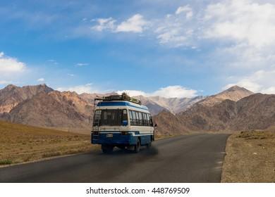 LEH LADAKH ,INDIA - SEPTEMBER 20, 2015 : Bus on the high altitude Leh road to Lamayuru on Leh Ladakh, India on September 20, 2015.