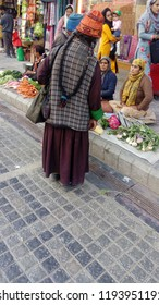 Leh, Ladakh, Jammu and Kashmir/ India - 10.08.2018: Street market and elderly tibetan woman