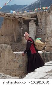 Leh, Ladakh - June 7 2017: Ladakhi Buddhist woman in street of the village of Leh, India