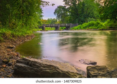 Lehigh Parkway's Robin Hood Bridge spans the Little Lehigh Creek in Allentown, Pennsylvania. This long exposure photograph was taken from the west side of the Little Lehigh Creek.