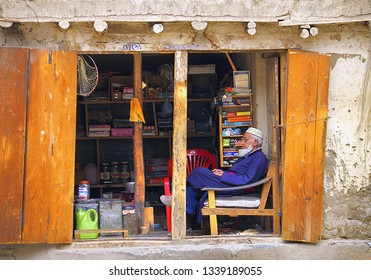 LEH/INDIA - JULY 01: Unidentified elderly muslim man sales writing goods and little things in his shop on July 01, 2017 in the city of Leh, Ladakh, Jammu & Kashmir, Northern India, Central Asia.