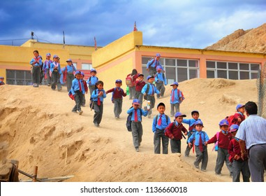 LEH/INDIA - JULY 01: Unidentified ladakhi school boys and girls dressed in uniform go home after classes on July 01, 2018 in Leh, Ladakh, Jammu & Kashmir, Northern India.
