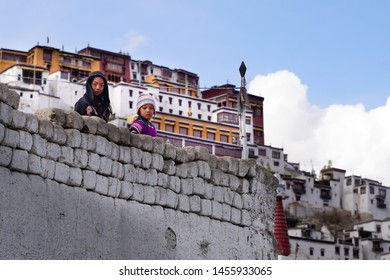 Leh/India-23.10.2018:The two tibetan girls staying and looking from the wall