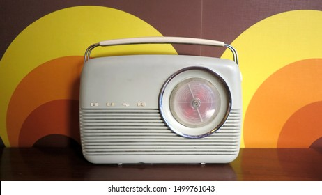 Leicester, England - 5 May 2019: Vintage radio from the 1960s with retro design wallpaper background