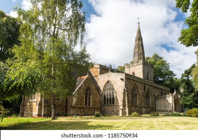 Leicester, England, UK - September 5, 2017: Sun shines on the traditional parish church and spire of St Denys in Evington in Leicester.