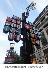 Leicester Square, City of Westminster, Central London, London, United Kingdom - 7 May 2019 : Cantonal tree displays the coats of arms of 26 cantons of Switzerland.