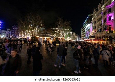 Leicester Square in London crowded with people among the Christmas decoration and illuminated buildings. London, England, UK - November 30, 2018