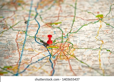 Leicester, UK - Circa May 2019: Shallow focus of the capital city of this English country. The city centre is donated by the push-pin also showing the busy road network on the paper planner.