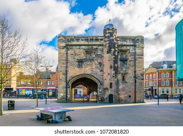 LEICESTER, UNITED KINGDOM, APRIL 10, 2017: People are passing the Newarke gateway in Leicester, England