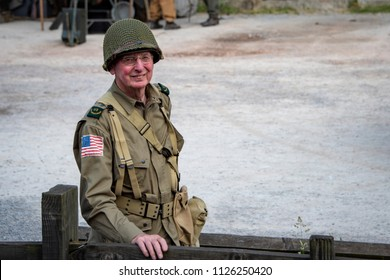 LEICESTERSHIRE,UK  - JUNE 03 2018: Man dressed in wartime US army soldiers uniform reenacting military maneuvers during Victory Day Europe Celebration Event at Great Central Railway , Quorn