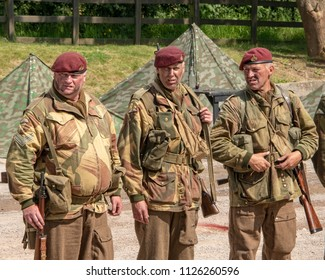 LEICESTERSHIRE,UK  - JUNE 03 2018: Men dressed in wartime US army soliders uniform reenacting military manouvers during Victory Day Europe Celebration Event at Great Central Railway, Quorn
