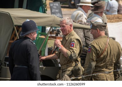 LEICESTERSHIRE,UK  - JUNE 03 2018: Men dressed in wartime uniforms talking together during Victory Day Europe Celebration Event at Great Central Railway, Quorn