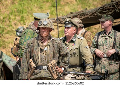 LEICESTERSHIRE,UK  - JUNE 03 2018: Men dressed in wartime German army soldiers uniform reenacting military maneuvers during Victory Day Europe Celebration Event at Great Central Railway, Quorn