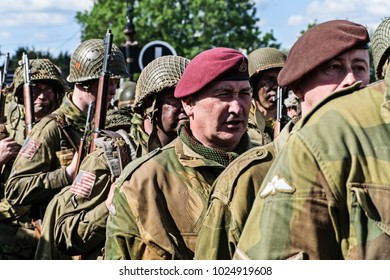 LEICESTERSHIRE,UK  - JUNE 07 2015: Men dressed in wartime US army soliders uniform reenacting military manouvers during Victory Day Europe Celebration Event at Great Central Railway, Quorn