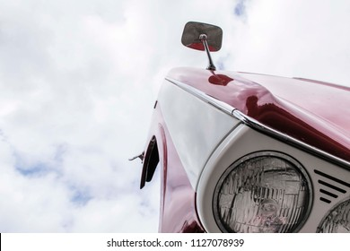 LEICESTERSHIRE,UK  - MAY 2015: Uplifted bonnet of a restored Triumph Herald . The Triumph Herald is a small two-door car introduced by the Standard-Triumph Company of Coventry in 1959 through to 1971.
