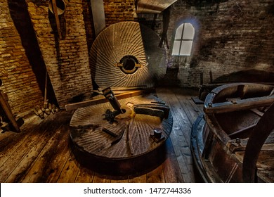 Leiden, Holland, Netherlands, April 21, 2019.Interiors of lofts (hoisting,stone and grinding) of the Molen De Valk museum (the Falcon windmill) traditional dutch flour mill gears,mill stone,machinery