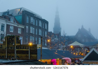 Leiden, Netherlands, 16-12-2018: A christmas market on a misty day in the city centre of Leiden, Netherlands
