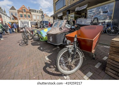 LEIDEN, NETHERLANDS - APRIL 15, 2016: Bike with front load carrying trailer parked at the center of Leiden.