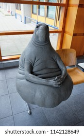 LEIDEN, THE NETHERLANDS – April 24, 2018: Homunculus loxodontus sculpture also known as Zhdun or Pochekun in Leiden, the Netherlands. It is an Internet meme symbolising waiting in a queue.
