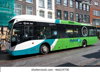 LEIDEN, THE NETHERLANDS - July 2, 2016: Van Hool A300 Hybrid bus at holding point Breestraat. Arriva operates bus, coach, train, tram and waterbus services in 14 countries across Europe.