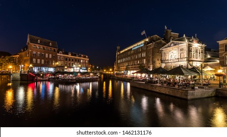 LEIDEN, NETHERLANDS, july 2019: Nightlife alongside canal in Leiden, Netherlands