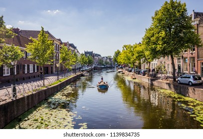 LEIDEN, THE NETHERLANDS - JUNE 27, 2018: Canals of Leiden, the Netherlands. Second only to Amsterdam, Leiden is the Dutch city with the most waterways.