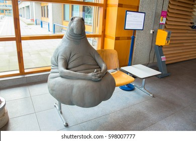 LEIDEN, THE NETHERLANDS – MARCH 11, 2017: Homunculus loxodontus, famous sculpture. Concept of patient waiting in the hospital.