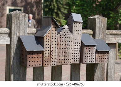 Leiden, The Netherlands - May 23, 2019; An artistic insect hotel hangs from the fence around the Clusius garden in the Hortus Botanicus