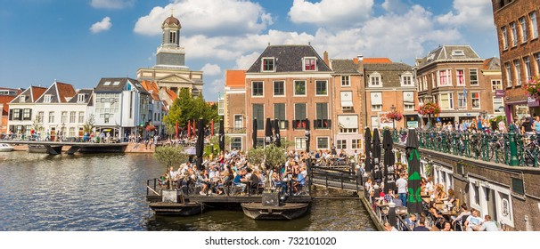 LEIDEN, NETHERLANDS - SEPTEMBER 03, 2017: Panorama of people enjoying the sun in the center of Leiden, Holland