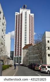 LEIPZIG, GERMANY - APRIL 8, 2016. View of Schutzenstrasse in Leipzig, Germany towards Wintergartenhochhaus residential tower, with cars and people.