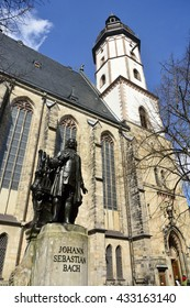 LEIPZIG, GERMANY - APRIL 8, 2016. View of the Thomaskirche in Leipzig, with statue of Johann Sebastian Bach in the foreground.