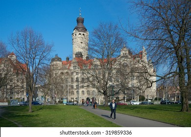 Leipzig, Germany - April 9 2015: People in Johannapark near the New Town Hall (1899-1905 by Hugo Licht).