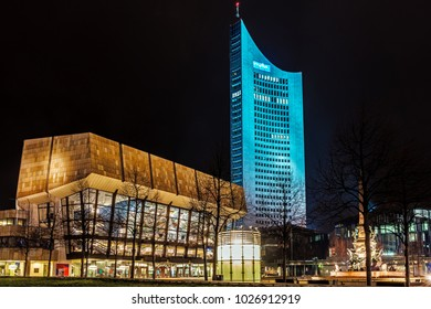LEIPZIG, GERMANY - FEBRUARY 8, 2018: Night view of Gewandhaus, a concert hall, the home of the Leipzig Gewandhaus Orchestra and City-Hochhaus, 36-storey skyscraper the tallest building in Leipzig.
