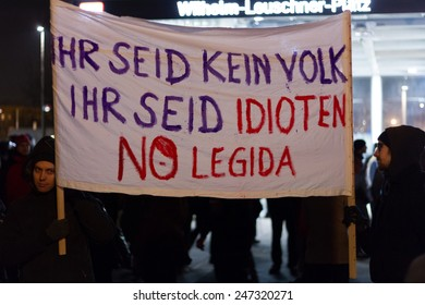 Leipzig, Germany - January 21: German protestants holding sign stating 'YOU ARE NOT PEOPLE, YOU ARE IDIOTS, NO LEGIDA' on January 21, 2014 in Leipzig, Germany