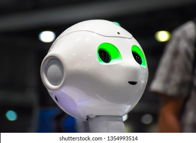 Leipzig, Germany - July 2, 2016: Four humanoid robots of type Nao of the French robot manufacturer Aldebaran Robotics are charged and programmed during a break of the RoboCup competition.