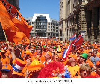 LEIPZIG, GERMANY - JUNE 11, 2006: Supporters of the National Soccer Team of the Netherlands on June 11, 2006 in Leipzig, Germany. They are  dressed in orange, being the National Color of Holland.