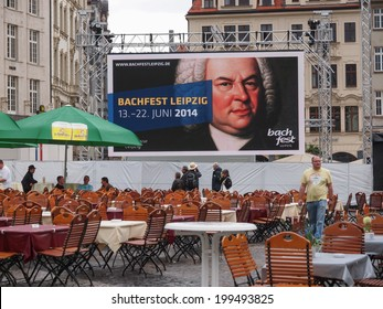 LEIPZIG, GERMANY - JUNE 14, 2014: People in beer garden at the Bachfest annual summer music festival celebrating baroque musician Johann Sebastian Bach in his town