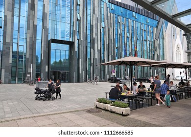 LEIPZIG, GERMANY - MAY 9, 2018: Students walk by Augusteum, main building of Leipzig University in Germany. The university exists since 15th century and currently has about 30,000 students.