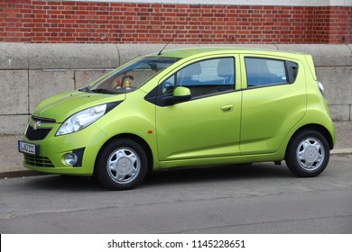 LEIPZIG, GERMANY - MAY 9, 2018: Chevrolet Spark green compact hatchback city car parked in Germany. There were 45.8 million cars registered in Germany (as of 2017).