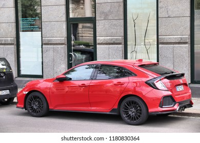 LEIPZIG, GERMANY - MAY 9, 2018: Red Honda Civic compact car in Germany. There were 45.8 million cars registered in Germany (as of 2017).